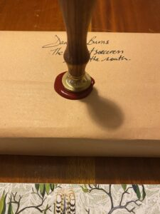 Sealing the signed paperback with wax